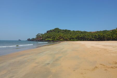Deserted beach north of Palolem in Goa, India photo