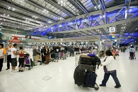 BANGKOK � JANUARY 17. People waiting in check-in line G terminal  of the Bangkok airport on January 17, 2012. Suvarnabhumi airport is world
