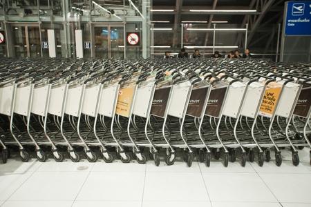 BANGKOK � JANUARY 17. Stacked empty trolleys in early morning Bangkok airport on January 17, 2012. Suvarnabhumi airport is world