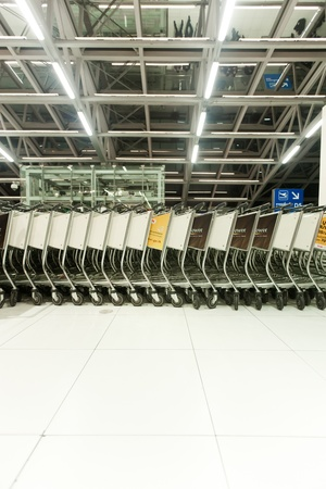 BANGKOK � JANUARY 17. Stacked empty trolleys in early morning Bangkok airport on January 17, 2012. Suvarnabhumi airport is world