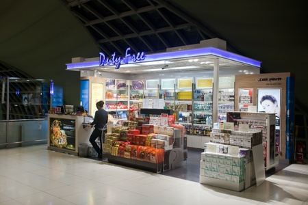 BANGKOK � JANUARY 17. Employee in Duty-free store in Bangkok airport on January 17, 2012. Suvarnabhumi airport is world