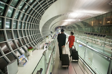 BANGKOK - JANUARY 17. Flight attendants entering departure terminal of Bangkok airport on January 17, 2012. Suvarnabhumi airport is worlds 4th largest single-building airport terminal.