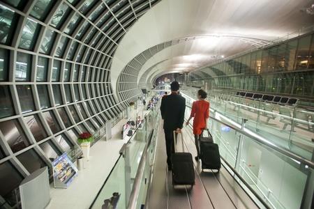 BANGKOK - JANUARY 17. Flight attendants entering departure terminal of Bangkok airport on January 17, 2012. Suvarnabhumi airport is world's 4th largest single-building airport terminal.