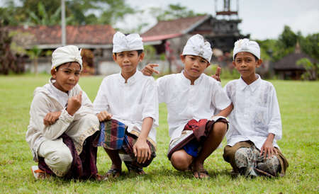 udeng: BALI - JANUARY 22. Balinese pilgrim children at Mother Temple in Besakih on January 22, 2012 in Bali, Indonesia. Most Balinese hindus make a yearly pilgrim to the mother of all temples in Bali.