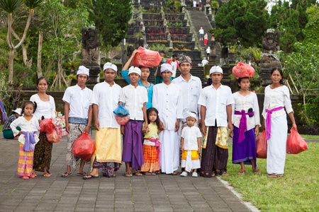 BALI - JANUARY 22. Balinese pilgrim family at Mother Temple in Besakih on January 22, 2012 in Bali, Indonesia. Most Balinese hindus make a yearly pilgrimage to the mother of all temples
