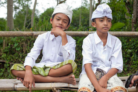 BALI - JANUARY 22. Balinese pilgrim children at Mother Temple in Besakih on January 22, 2012 in Bali, Indonesia. Most Balinese hindus make a yearly pilgrim to the mother of all temples.