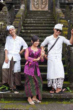 BALI - JANUARY 22. Young Balinese pilgrims at Mother Temple in Besakih on January 22, 2012 in Bali, Indonesia. Most Balinese hindus make a yearly pilgrimage to the mother of all temples