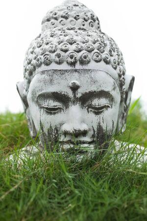 stone buddha: Stone Buddha decoration bust in garden grass