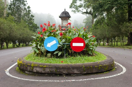 No entry and arrow sign in the botanical gardens in Bali, Indonesia Stock Photo - 12772491