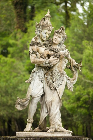 Hindu god and goddess in the botanical gardens in Bali, Indonesia. photo