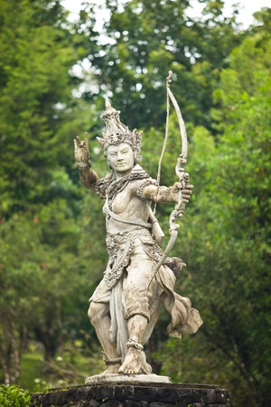 hindu temple: Hindu god with bow in the botanical gardens in Bali, Indonesia.
