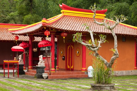 chinese temple: Red hindu temple and gardens in Bali in Indonesia