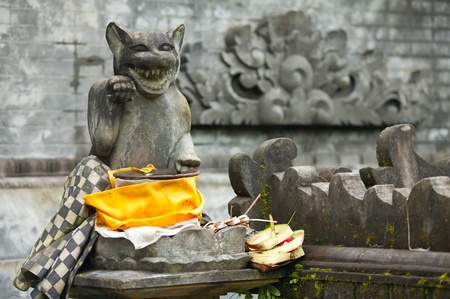 maneki: Beckoning cat at the entrance to hindu temple in Bali, Indonesia