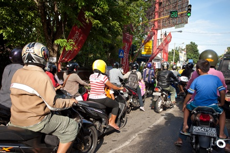 BALI - JANUARY 26. Traffic jam on streets in Denpasar on January 26, 2012 in Bali, Indonesia. Roads on the island are getting more congested as population increases.