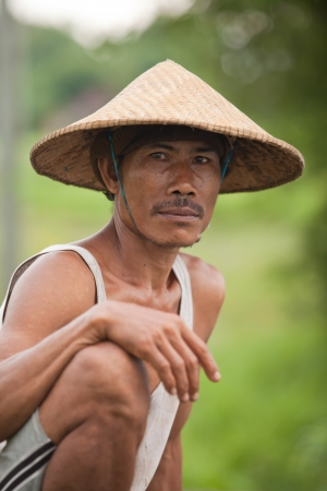 BALI - JANUARY 29  Portrait of traditional rice farmer on January 29, 2012 in Bali, Indonesia  Indonesia is currently the world Editorial