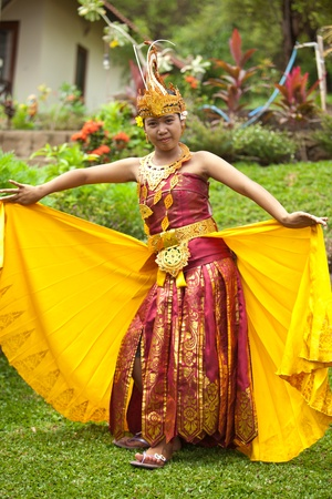 cultural clothing: Young Balinese female dancer performing traditional Legong dance
