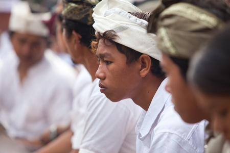 BALI - FEBRUARY 1. Village gathering in local temple for Galungan ceremony on February 1, 2012 in Bali, Indonesia. Galungan's a Balinese holiday occuring every 210 days lasting 10 days. Stock Photo - 13336628