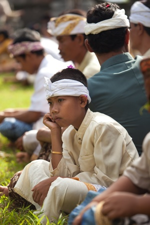 udeng: BALI - FEBRUARY 1. Village gathering in local temple for Galungan ceremony on February 1, 2012 in Bali, Indonesia. Galungans a Balinese holiday occuring every 210 days lasting 10 days.