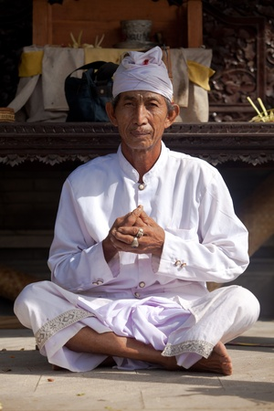 BALI - FEBRUARY 1. Hindu priest praying in local temple for Galungan ceremony on February 1, 2012 in Bali, Indonesia. Galungan's a Balinese holiday occuring every 210 days lasting 10 days. Stock Photo - 13336641
