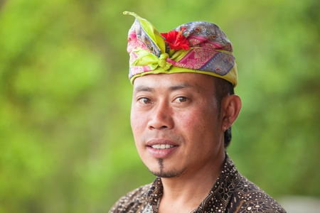 BALI - FEBRUARY 2. Balinese man wearing colourful Udeng on head on February 2, 2012 in Bali, Indonesia. Udengs come in different colours depending on the importance of the event.