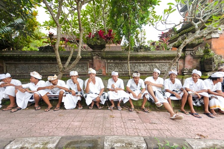 udeng: BALI - FEBRUARY 2. Balinese man men gathering in front of temple for ceremony on February 2, 2012 in Bali, Indonesia. Its traditional in Bali to dress in white when going to the hindu temple. Editorial