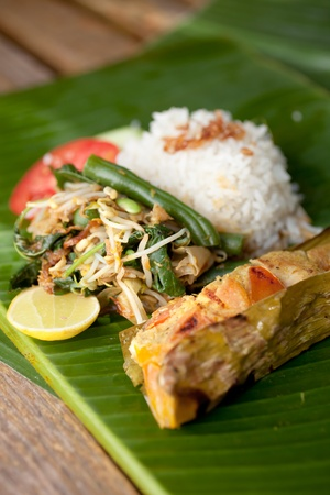 Special indonesian fish dish, Pepes Ikan, served on banana leaf