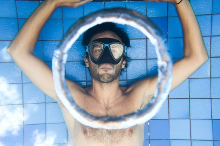 Man making bubble rings underwater in pool Stock Photo - 13452290