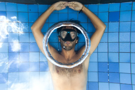 Man making bubble rings underwater in pool Stock Photo - 13383526