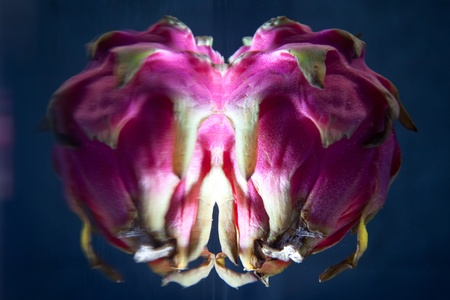 Abstract looking Dragon fruit underwater with surface reflection photo