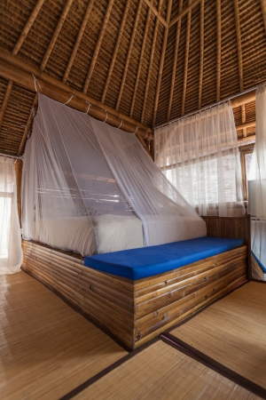 Bamboo bed in a bamboo bedroom in a bamboo house