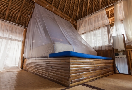 architecture bungalow: Bamboo bed in a bamboo bedroom in a bamboo house