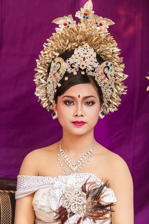 BALI - FEBRUARY 11. Woman enacting wedding scene in preparation for religious ceremony on February 11, 2012 in Bali, Indonesia. Most Balinese get married in their early 20s. Stock Photo - 13666255