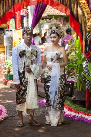 BALI - FEBRUARY 11. Couple enacting wedding scene in preparation for religious ceremony on February 11, 2012 in Bali, Indonesia. Most Balinese get married in their early 20s. Stock Photo - 13666260