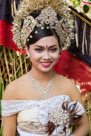 BALI - FEBRUARY 11. Woman enacting wedding scene in preparation for religious ceremony on February 11, 2012 in Bali, Indonesia. Most Balinese get married in their early 20s.