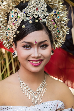 BALI - FEBRUARY 11. Woman enacting wedding scene in preparation for religious ceremony on February 11, 2012 in Bali, Indonesia. Most Balinese get married in their early 20s. Stock Photo - 13666249