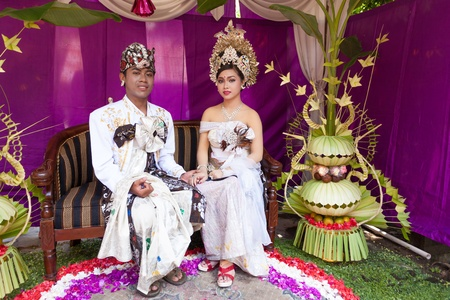 BALI - FEBRUARY 11. Couple enacting wedding scene in preparation for religious ceremony on February 11, 2012 in Bali, Indonesia. Most Balinese get married in their early 20s. Stock Photo - 13666243
