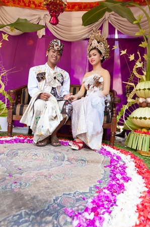 BALI - FEBRUARY 11. Couple enacting wedding scene in preparation for religious ceremony on February 11, 2012 in Bali, Indonesia. Most Balinese get married in their early 20s. Stock Photo - 13666237