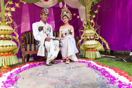 BALI - FEBRUARY 11. Couple enacting wedding scene in preparation for religious ceremony on February 11, 2012 in Bali, Indonesia. Most Balinese get married in their early 20s. Stock Photo - 13666245