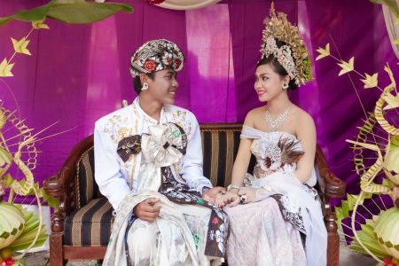 BALI - FEBRUARY 11. Couple enacting wedding scene in preparation for religious ceremony on February 11, 2012 in Bali, Indonesia. Most Balinese get married in their early 20s. Stock Photo - 13666240
