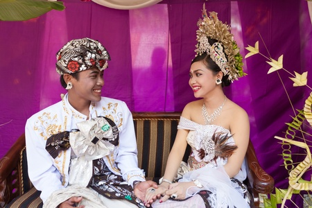 BALI - FEBRUARY 11. Couple enacting wedding scene in preparation for religious ceremony on February 11, 2012 in Bali, Indonesia. Most Balinese get married in their early 20s. Stock Photo - 13666238