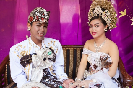 BALI - FEBRUARY 11. Couple enacting wedding scene in preparation for religious ceremony on February 11, 2012 in Bali, Indonesia. Most Balinese get married in their early 20s. Stock Photo - 13666235