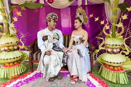BALI - FEBRUARY 11. Couple enacting wedding scene in preparation for religious ceremony on February 11, 2012 in Bali, Indonesia. Most Balinese get married in their early 20s. Stock Photo - 13666256