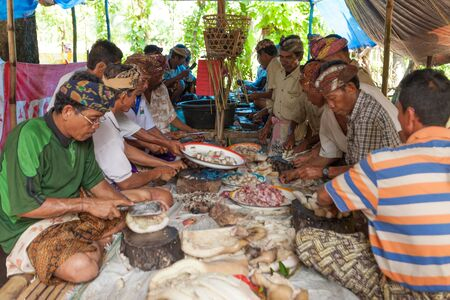 BALI - FEBRUARY 11. Villagers prepare food for wedding ceremony on February 11, 2012 in Bali, Indonesia. This fishing village community eat mostly pork. Stock Photo - 13669982