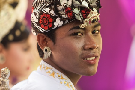 BALI - FEBRUARY 11. Performers enacting wedding scene in preparation for religious ceremony on February 11, 2012 in Bali, Indonesia. Most Balinese get married in their early 20s. Stock Photo