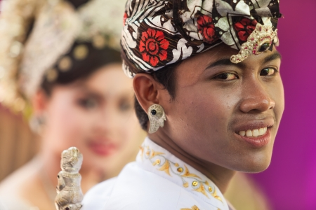 celebratation: BALI - FEBRUARY 11. Performers enacting wedding scene in preparation for religious ceremony on February 11, 2012 in Bali, Indonesia. Most Balinese get married in their early 20s. Stock Photo