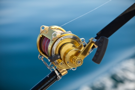 fishing catches: big game fishing reels in natural setting