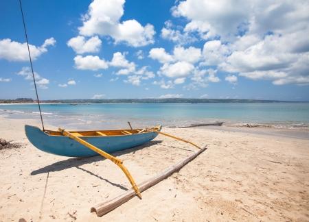 Traditional fishing boat on Jimberan beach in Bali, Indonesia. photo
