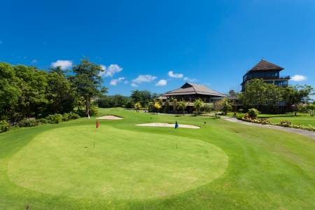 Green and holes in front of Golf clubhouse in Bali, Indonesia Editorial