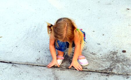 A little blonde girl with pigtails playing in the dirt Stock Photo - 4665099