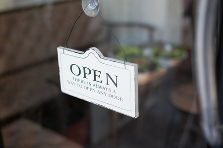 coffeeshop: Open sign on a glass door in front of a shop or a coffeeshop
